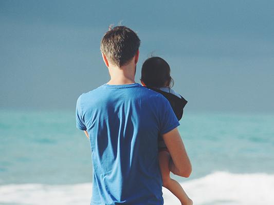 Parent holding child