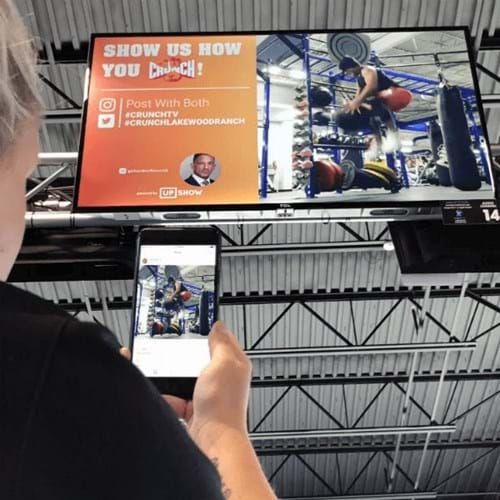 Person sending pictures from phone to big screen