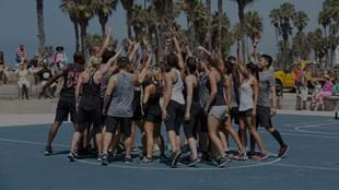 The LES MILLS GRIT™ team celebrate after an awesome workout at Venice Beach