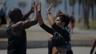 LES MILLS GRIT™ coaches Sheldon and Nikki share a moment on the blacktop