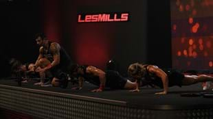 Amir coaches the BODYPUMP™ crowd through the shoulder track