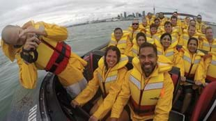 Lisa Collins and Mark Nu'u taking time out on a jet boat ride around Auckland harbour.