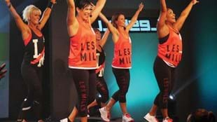 Lisa Collins takes to the stage during the filming of BODYSTEP™ 100.