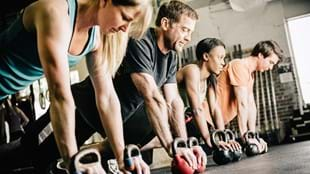 Exercisers with kettlebells