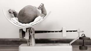 Newborn baby on scales